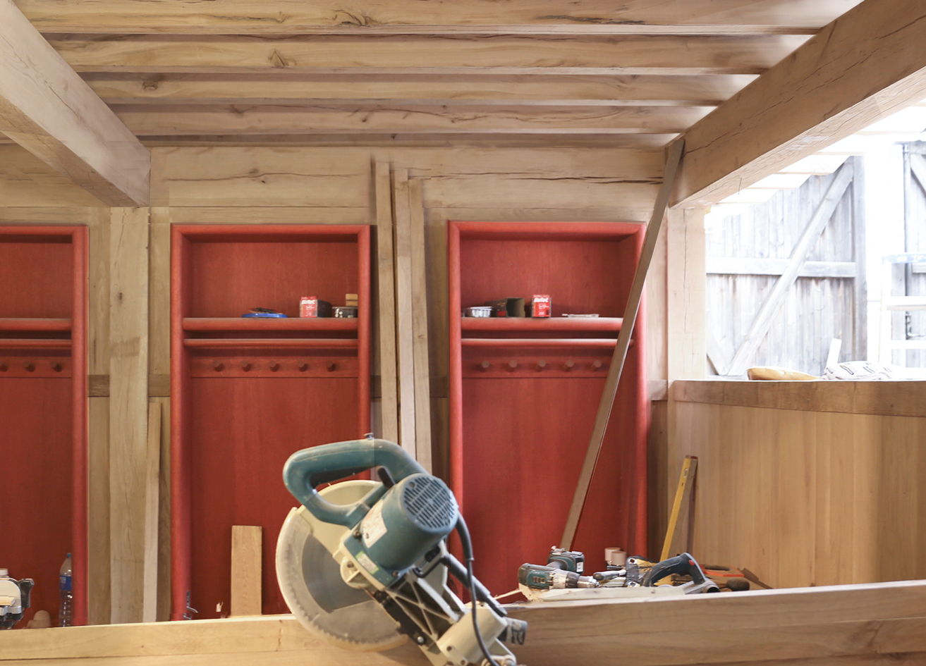 red club lockers within the timber structure