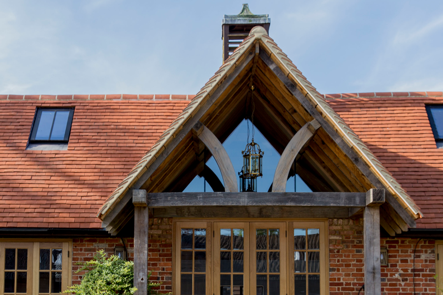 oak gable porch and terracotta tiled roof