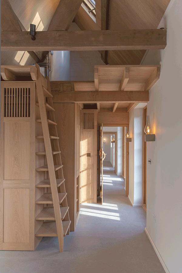 oak interior with ship's ladder and lanterns