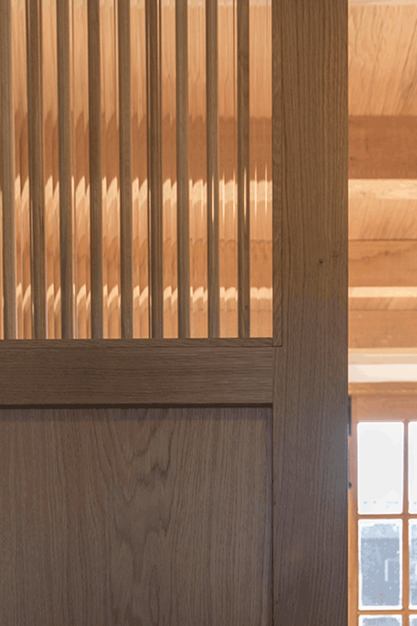 wooden partition with reeded glass