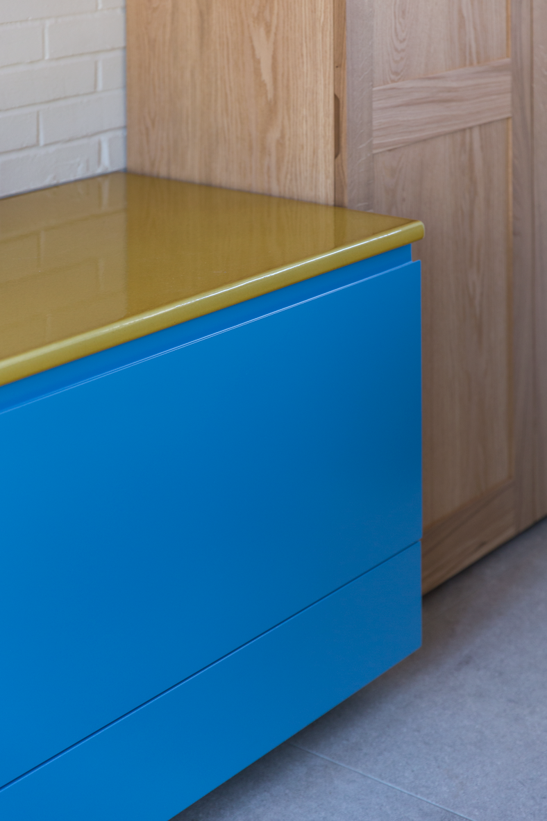 yellow stone counter on blue kitchen cabinet