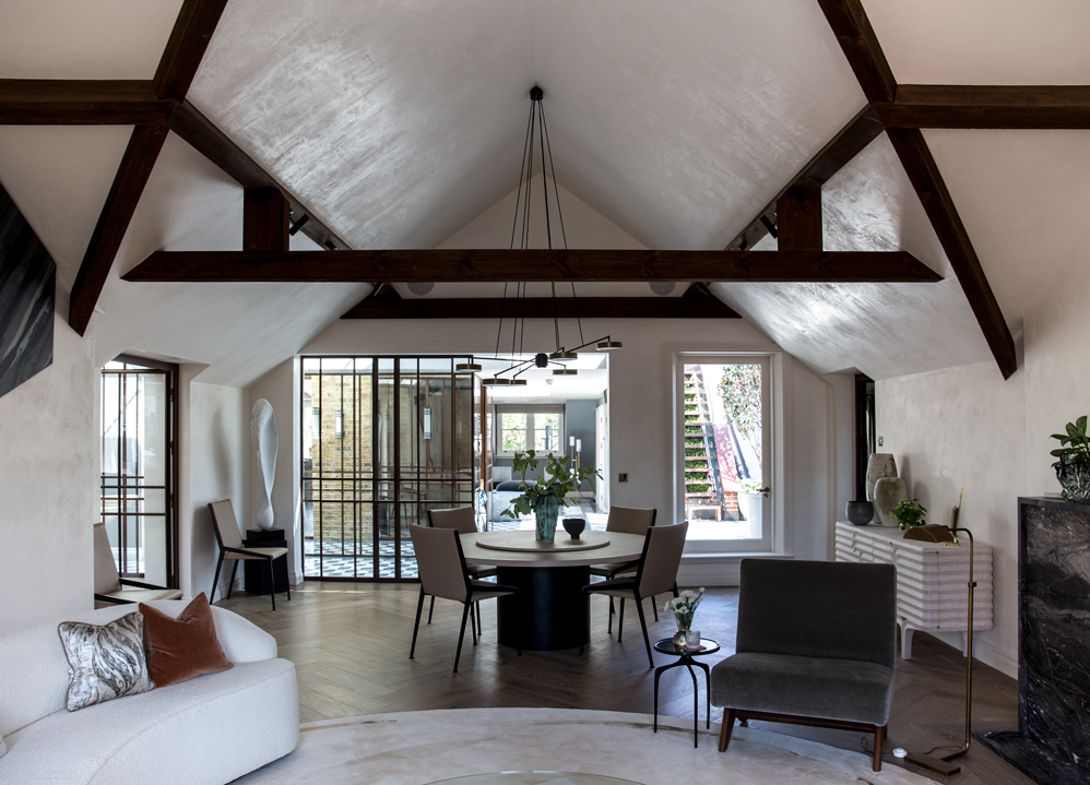 contemporary living room with exposed timber beams