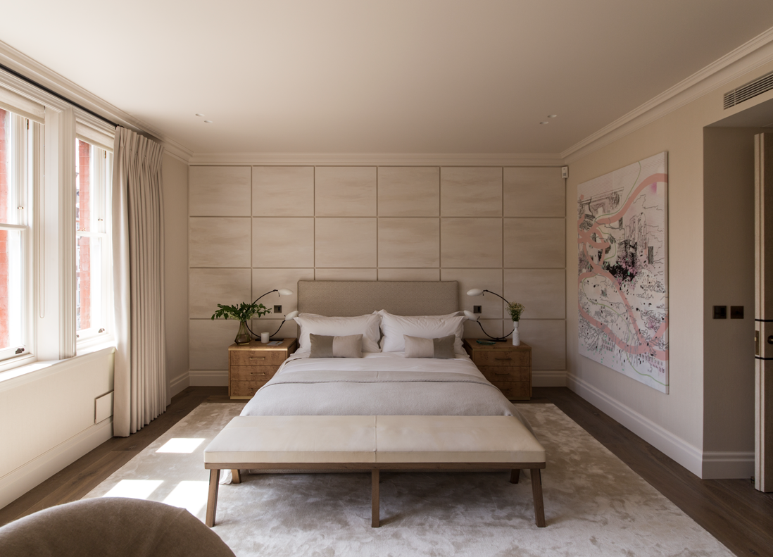 master bedroom with panelled wall